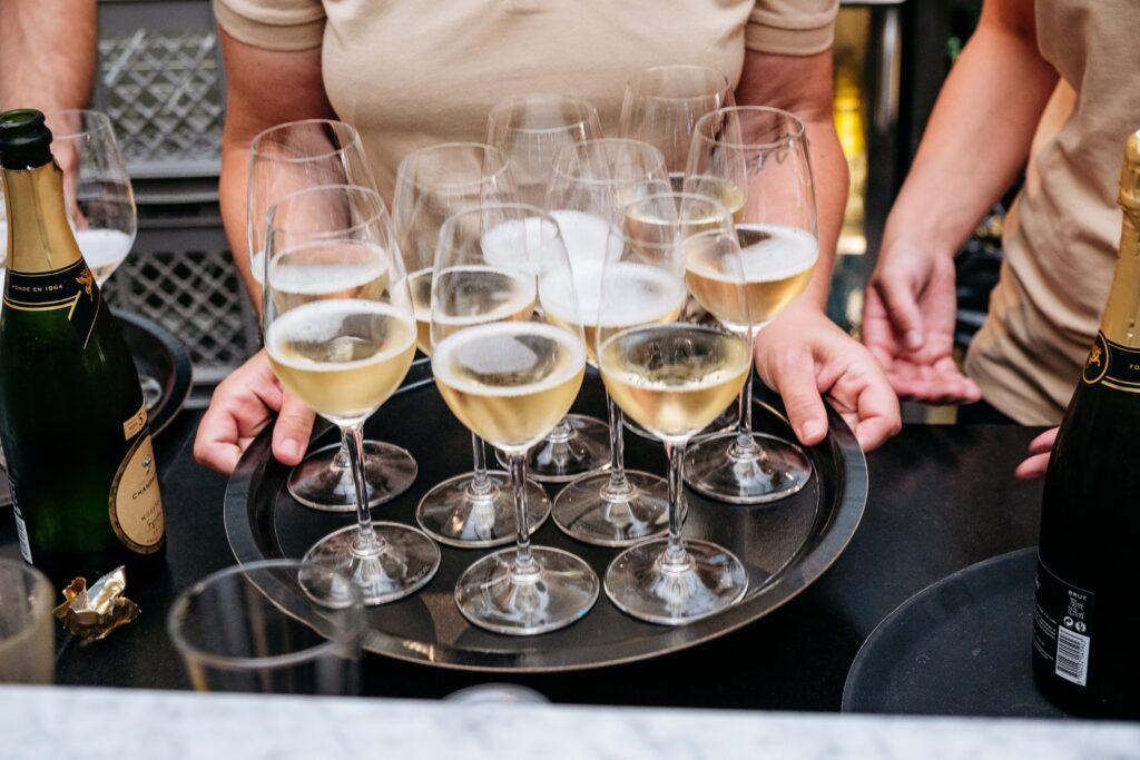 Open for Business: Fizz Champagne and Bubbles Bar champagne served on tray
